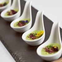 Smoked asparagus soup, ham hock & micro flower